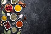 Set Of Various Spices And Herbs On Black Stone Table. Top View With Copy Space. Food Background. poster