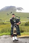Playing Bagpiper