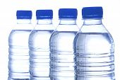 stock photo of bottle water  - image of four bottled water in line - JPG