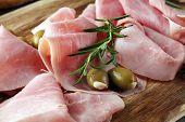 Sliced Ham On Wooden Board. Fresh Prosciutto. Pork Ham Sliced. poster