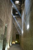 Corridor Inside An Ancient Egyptian Temple With Light Beams