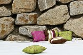 Pillows In Front Of Rocks