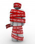 A person is wrapped in red tape marked Help, representing getting caught in a problem or trouble and