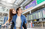 Young Asian Couple Having Fun And Playing At Airport Terminal. Happy Asia Lovers Are Traveling Honey poster