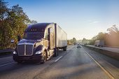 18 Wheeler Semi Truck On Highway With Sun Lens Flare poster