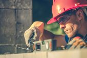 Caucasian Masonry Worker In Hard Hat. Construction Site Theme. poster
