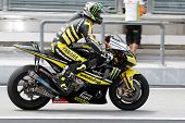 SEPANG, MALAYSIA - FEBRUARY 22: MotoGP rider Cal Crutchlow of Monster Yamaha Tech 3 team practices a