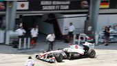 SEPANG, MALAYSIA - APRIL 8: Kamui Kobayashi of Sauber F1 Team returns to the pit for checks on the f