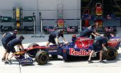 SEPANG, MALAYSIA - APRIL 8: Scuderia Toro Rosso pit crew works on Sebastien Buemi's car during pit-s