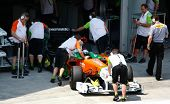 SEPANG, MALAYSIA - APRIL 8: Force India F1 Team pit crew pushes Adrian Sutil back into the pits on t