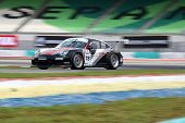 SEPANG - JUNE 17: Shim Ching in a Porsche 997 Cup 3.8 takes to the tracks of the Sepang Internationa