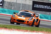 SEPANG - JUNE 17: Chew Ruoh Peng in a Lotus Exige S AM-01takes to the tracks of the Sepang Internati
