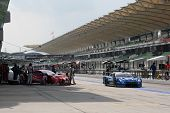SEPANG - JUNE 19: Team Impul's Nissan GTR car leaves the pit-lane after tire change at the practice