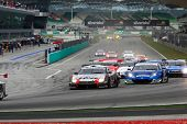SEPANG - JUNE 19: Cars take off from a rolling start at the Japan SUPER GT Round 3 race at the Sepan