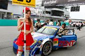 SEPANG, MALAYSIA - JUNE 19: Samurai Team Tsuchiya's race queen poses in front of the team's car at t