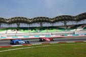 SEPANG, MALAYSIA - JUNE 19: NISMO's Nissan GT-R R35 (#23) leads the Team Impul's car during practice