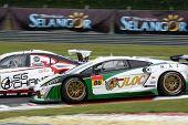SEPANG, MALAYSIA - JUNE 19: JLOC's Lamborghini Gallardo RGF-3 car races down turn 2 of the Sepang In