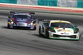 SEPANG - JUNE 19: The Lamborghini Gallardo (86) of the JLOC accelerates into turn 2 of the Sepang In