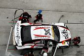 SEPANG, MALAYSIA - JUNE 19: Team SG Changi car pits for refuel, and driver and tire change at the Se