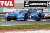 SEPANG - JUNE 18: The Nissan GTR R35 car of Team IMPUL takes to the tracks of the Sepang Internation