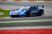 SEPANG, MALAYSIA - JUNE 18: The Nissan GTR R35 car of Team IMPUL does practice laps on the Sepang In