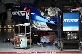 SEPANG - JUNE 18: The mechanics of Keihin Real Racing working on the Honda HSV-010 car in the garage