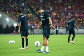 BUKIT JALIL, MALAYSIA - JULY 13: Arsenal's captain Robin van Persie warms up before the game against