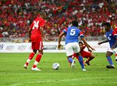 BUKIT JALIL, MALAYSIA - JULY 16: Liverpool's David Ngog (24) and Malaysia's M. Rizal (5) go after a