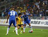 BUKIT JALIL, MALAYSIA - JULY 21: Chelsea's Ashley Cole (blue) controls the ball watched by Nicolas Anelka (39) in a game with Malaysia at the National Stadium on July 21, 2011 in Bukit Jalil, Malaysia.