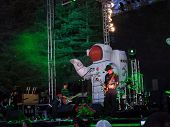 Primus Jams Guitars On Outdoor Stage At Night