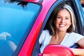 image of family vacations  - Happy smiling woman in a car - JPG