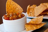 stock photo of chipotle  - Peach Mango Salsa with chipotle Chips  - JPG