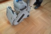 Sanding Hardwood Floor With The Grinding Machine. Repair In The Apartment. Carpenter Doing Parquet W poster