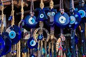 Evil Eye Bead Souvenirs.broken Glass Is Melted And Shaped. In Culture And Religious Belief, The Figu poster