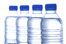 picture of bottle water  - image of four bottled water in line - JPG