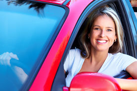 foto of family vacations  - Happy smiling woman in a car - JPG