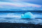 Iceland, famous black beach with icebergs also known as Diamond beach, Jokulsarlon glacier lagoon, b poster
