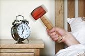 foto of turn-up  - Smashing alarm clock with hammer concept for sleeping in - JPG