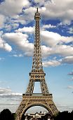Eiffel Tower Symbol Of The City Of Paris With Hdr Effect And The White Clouds In The Blue Sky poster
