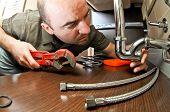 funny portrait of caucasian plumber on duty