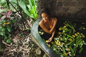 Beautiful Young Woman Enjoying In Outdoor Spa. Luxury Stone Bath Tub With Jungle View. Natural Organ poster