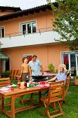 image of nic  - Family having a barbecue in the garden - JPG