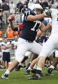 Penn State linemen #77 Lou Eilades blocks