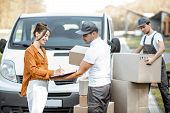 Courier Delivering Goods To A Young Woman By Cargo Van Vehicle, Client Signing Documents, Mover With poster