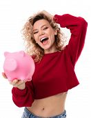 Caucasian Girl With Curly Fair Hair Holds A Pink Pig Moneybox, Portrait Isolated On White Background poster