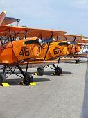 Three orange biplanes