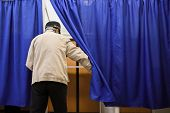 Shallow Depth Of Field (selective Focus) Image With A Man Casting His Ballot In The First Round Of A poster
