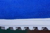 Blue White Texture Of Plastic Sole And Suede On Shoes poster