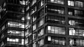 Pattern Of Office Buildings Windows Illuminated At Night. Lighting With Glass Architecture Facade De poster