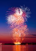 stock photo of firework display  - Colorful firework in a night sky reflection in water - JPG